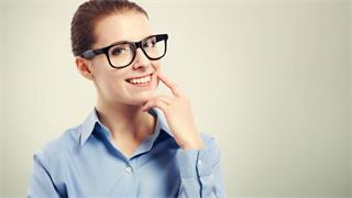 How is myopia corrected with glasses?